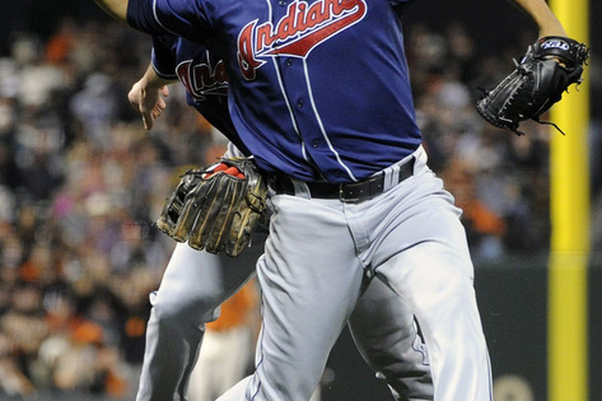 Carlos Carrasco plays fetch with an unidentified Indians player.