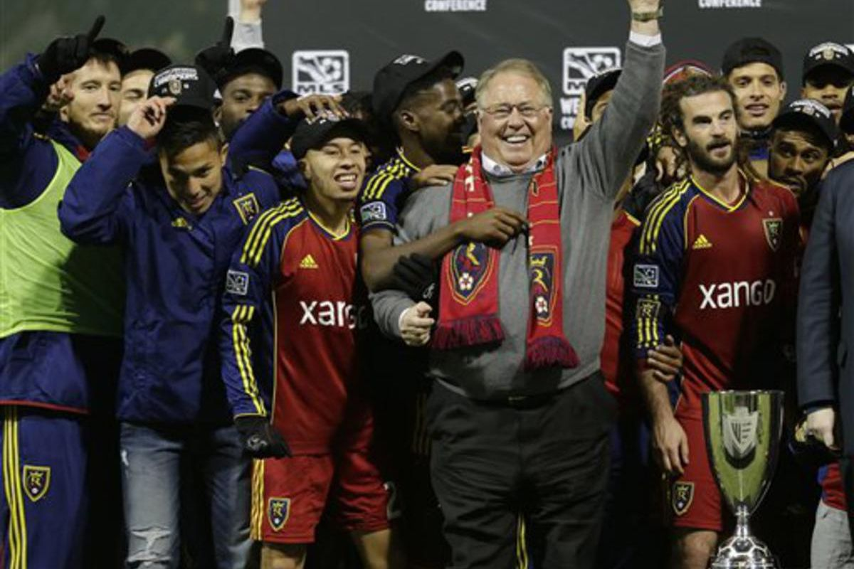 Real Salt Lake owner Dell Loy Hansen, center, celebrates with players after Real Salt Lake's beat the Portland Timbers for the Western Conference championship in the MLS Cup soccer playoffs, Sunday, Nov. 24, 2013, in Portland, Ore. (AP Photo/Ted S. Warren