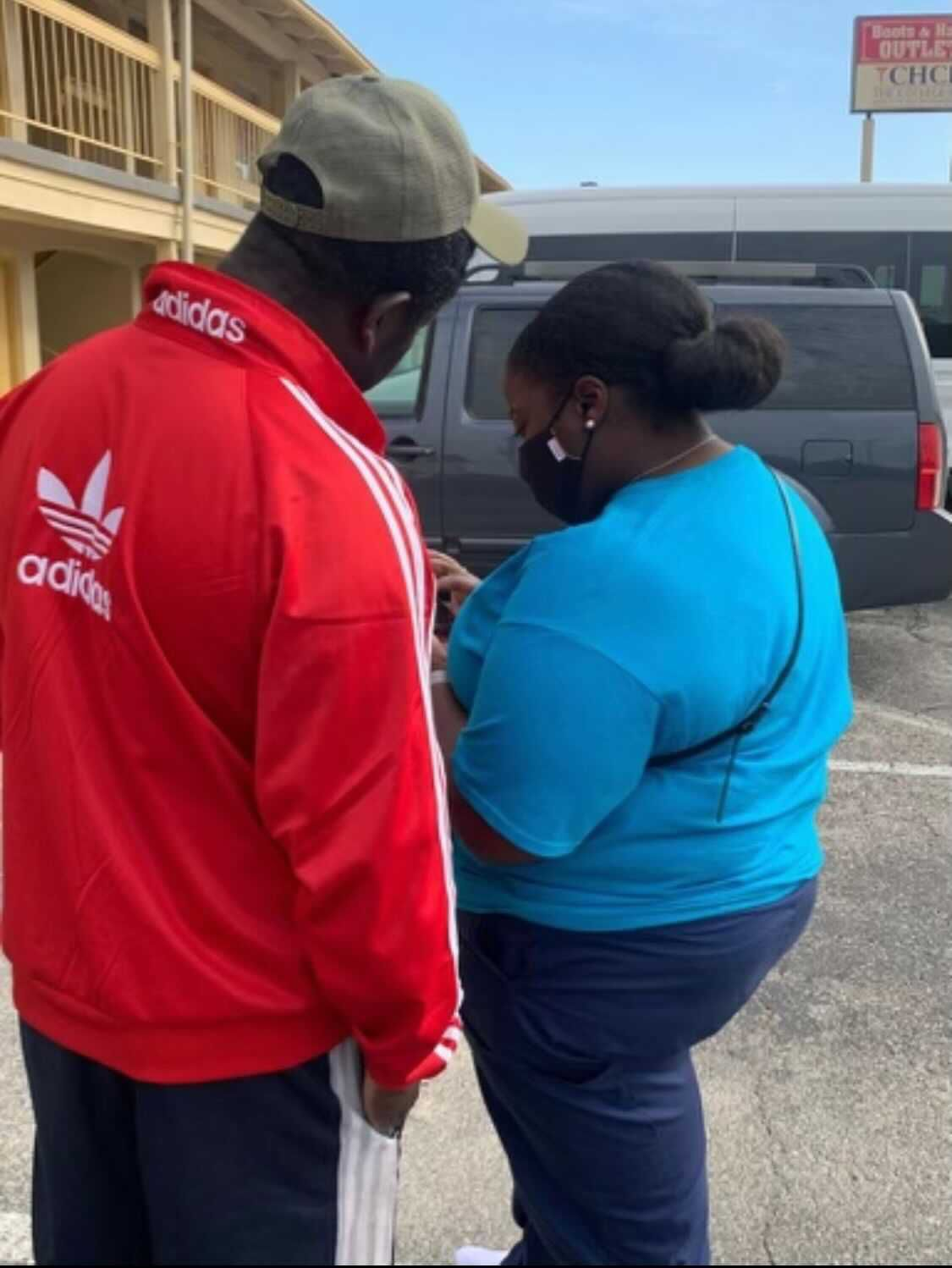 Patricia Nabal, the president of the Haitian American Nurses Association of Illinois, is among a group of Haitian community members from Chicago who recently traveled to the U.S. southern border to assess how they could assist Haitian migrants seeking asylum. Nabal is pictured speaking to a man she met on the trip.
