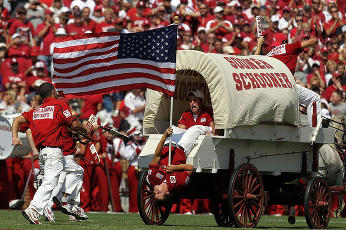NORMAN OK - SEPTEMBER 11:  The Oklahoma Sooner Schooner carries the American flag on the anniversary of September 11  at Gaylord Family Oklahoma Memorial Stadium on September 11 2010 in Norman Oklahoma.  (Photo by Ronald Martinez/Getty Images)
