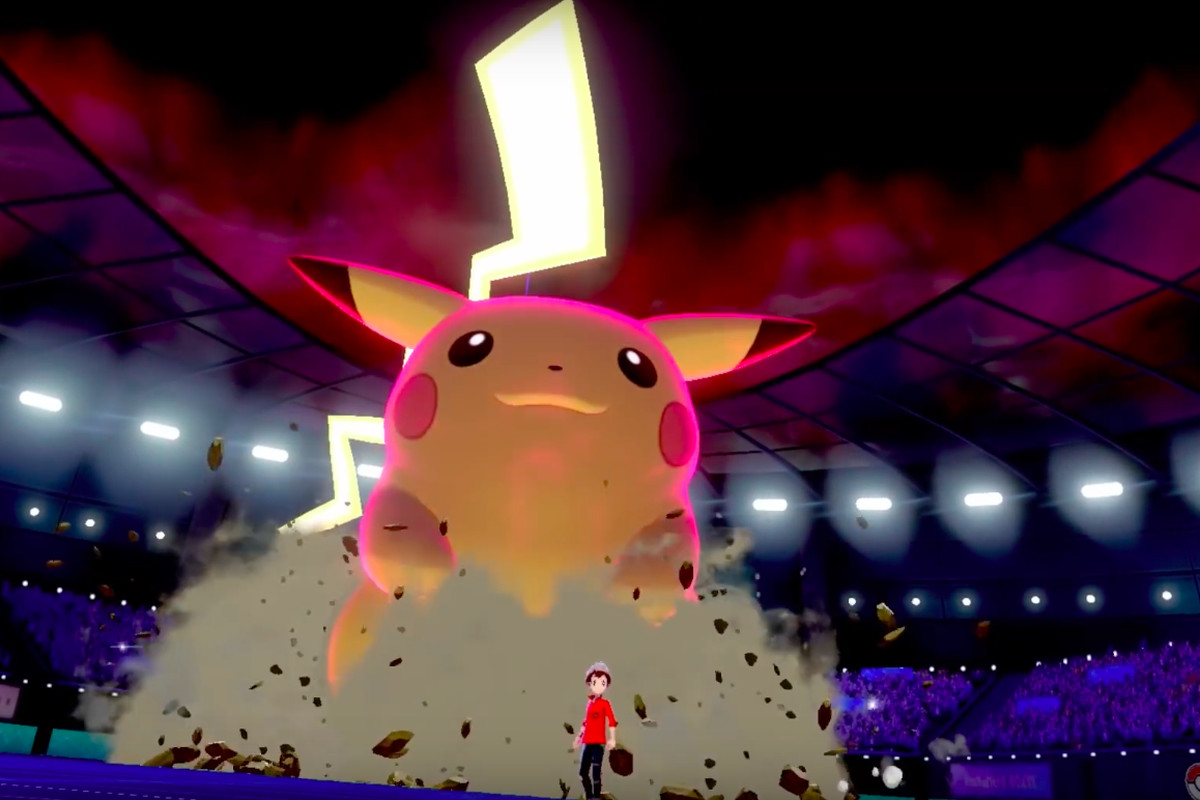 A giant Pikachu looms over a stadium.