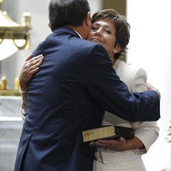 Gov. Gary Herbert gets a hug from his wife, Jeanette, after being sworn in Tuesday.