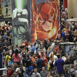 Crowds walk through the exhibit hall on the last day of the Comic-Con International 2011 convention held in San Diego Sunday, July 24, 2011. The annual comic book and popular arts convention attracts over 100,000 people and runs through Sunday July 24.