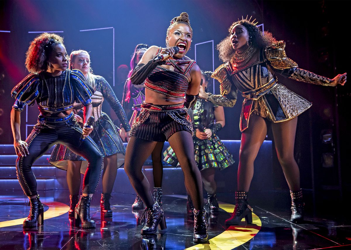 """Anna of Cleves (BrittneyMack, at center) performs """"GetDown"""" in Chicago Shakespeare Theater's North American Premiere production of""""Six,"""" written by TobyMarlow and LucyMoss and directed by LucyMoss and JamieArmita"""