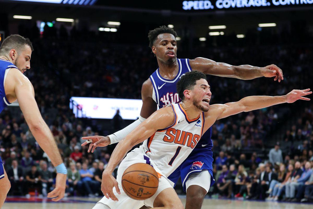 Phoenix Suns guard Devin Booker dribbles the ball around Sacramento Kings guard Buddy Hield during the third quarter at Golden 1 Center.