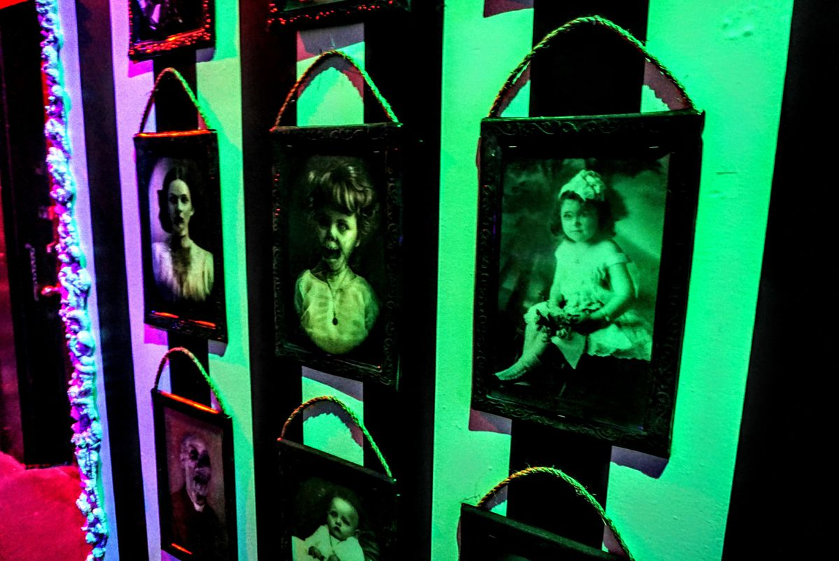 halloween decor with portraits of dead vintage people