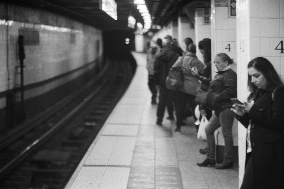 People waiting for train on NYC subway platform