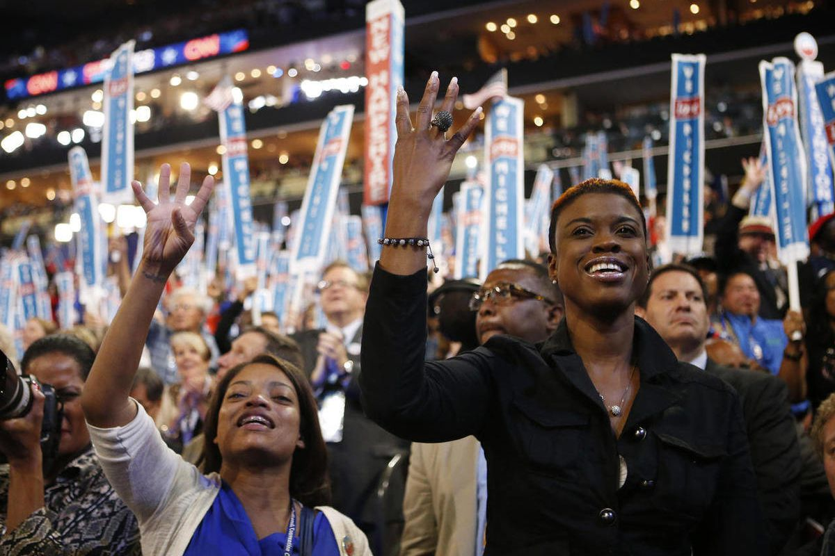 Delegates cheer as first lady Michelle Obama addresses the Democratic National Convention in Charlotte, N.C., on Tuesday, Sept. 4, 2012.