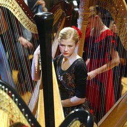 FILE - Elizabeth Smart performs the harp with the Salt Lake Symphony at Abravanel Hall Saturday Feb. 14, 2004 in Salt Lake City.
