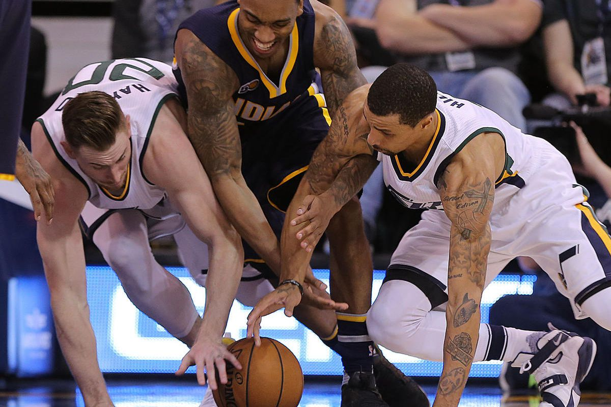 FILE: Utah Jazz forward Gordon Hayward (20) and Utah Jazz guard George Hill (3) wrestle with Indiana Pacers guard Jeff Teague (44) for the ball as the Jazz and the Pacers play at Vivint Smart Home Arena in Salt Lake City on Saturday, Jan., 21, 2017.
