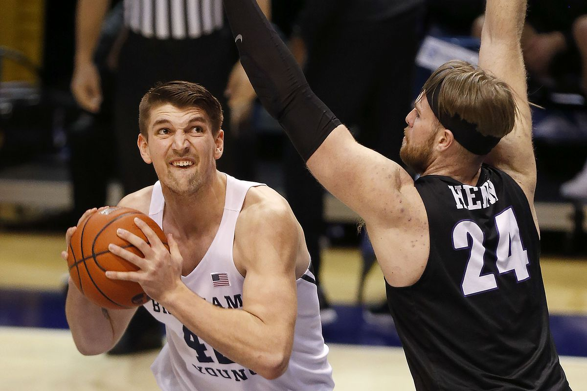Brigham Young Cougars center Richard Harward (42) gets ready to shoot over Portland Pilots forward Mikey Henn (24) at the Marriott Center in Provo on Thursday, Jan. 21, 2021.