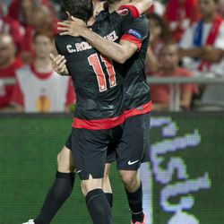Atletico Madrid's Diego Costa, right, celebrates a goal with Atletico Madrid's Cristian RodrÍguez during their Europa League Group B soccer match against Hapoel Tel Aviv at the Bloomfield stadium in Tel Aviv, Israel,Thursday, Sept. 20, 2012.