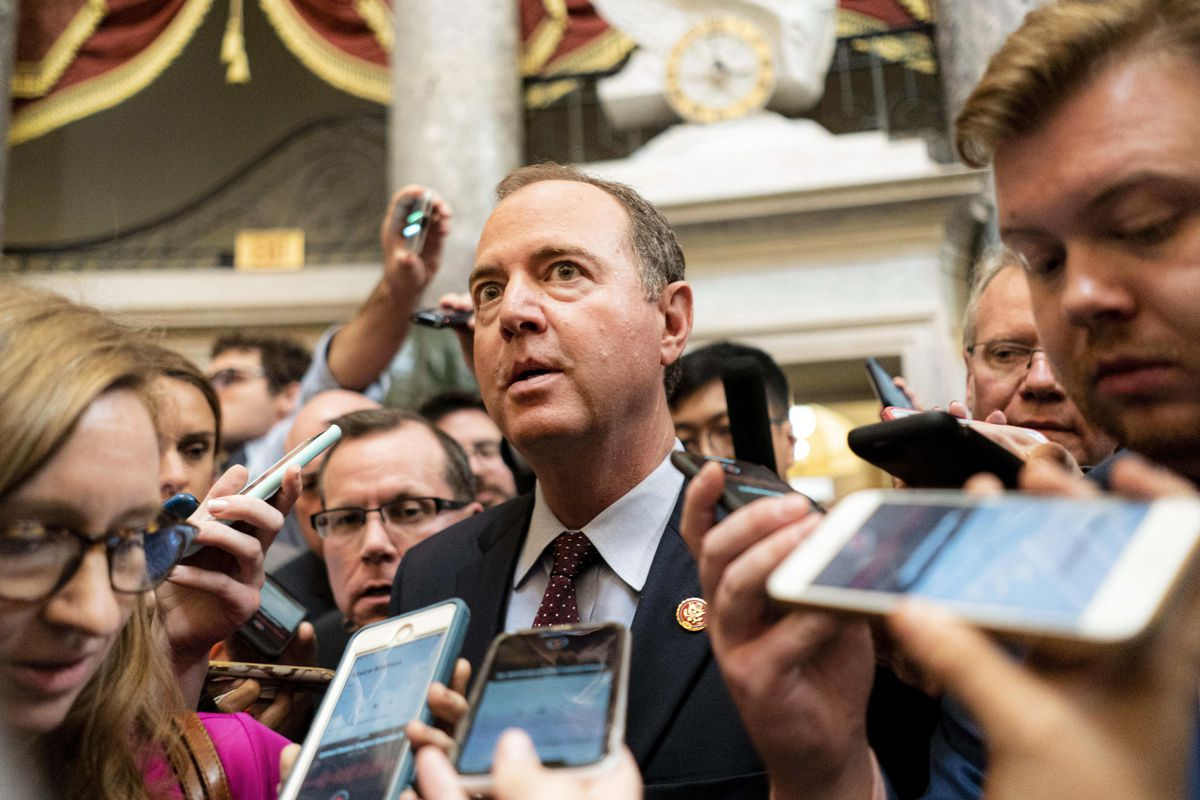 Chairman of the House Intelligence Committee Rep. Adam Schiff surrounded by reporters.