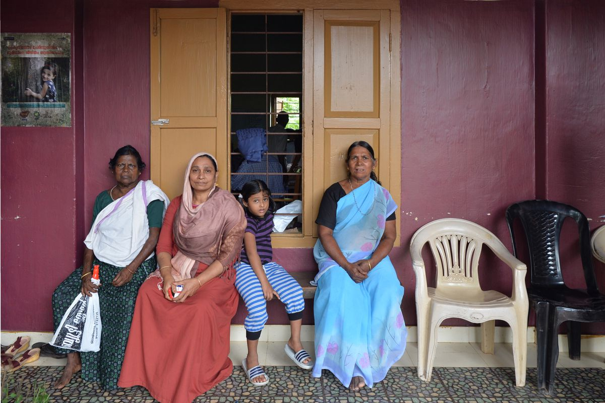 Indian flood victims wait for a doctor at a medical center in a flood-relief camp in the Kozhikode District on August 17.