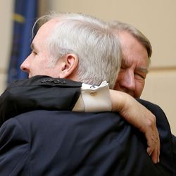 Ric Cantrell, Utah Senate chief of staff, and John Valentine, chairman of the Utah State Tax Commission, greet one another at the first day of the Utah Legislature at the Capitol in Salt Lake City on Monday, Jan. 25, 2016.