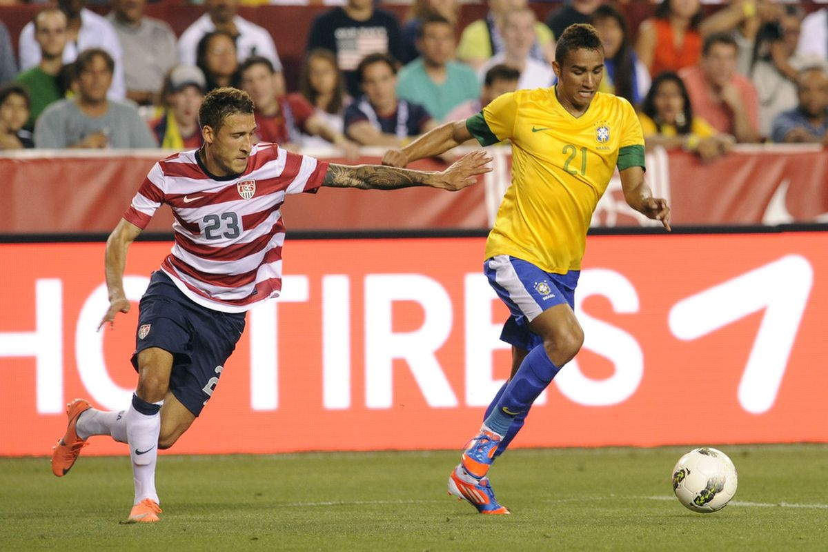 May 30, 2012; Landover, MD, USA; USA midfielder Fabian Johnson (23) reaches out for Brazil defender Danilo (21) during the second half of a men's international friendly match at FedEx Field.  Mandatory Credit: Rafael Suanes-US PRESSWIRE