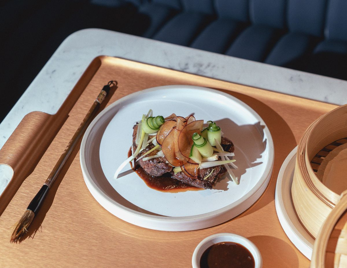 Crispy duck pancakes at Kym's in the Bloomberg Arcade restaurant development, London - the follow-up to Michelin-starred dim sum restaurant A. Wong in Victoria