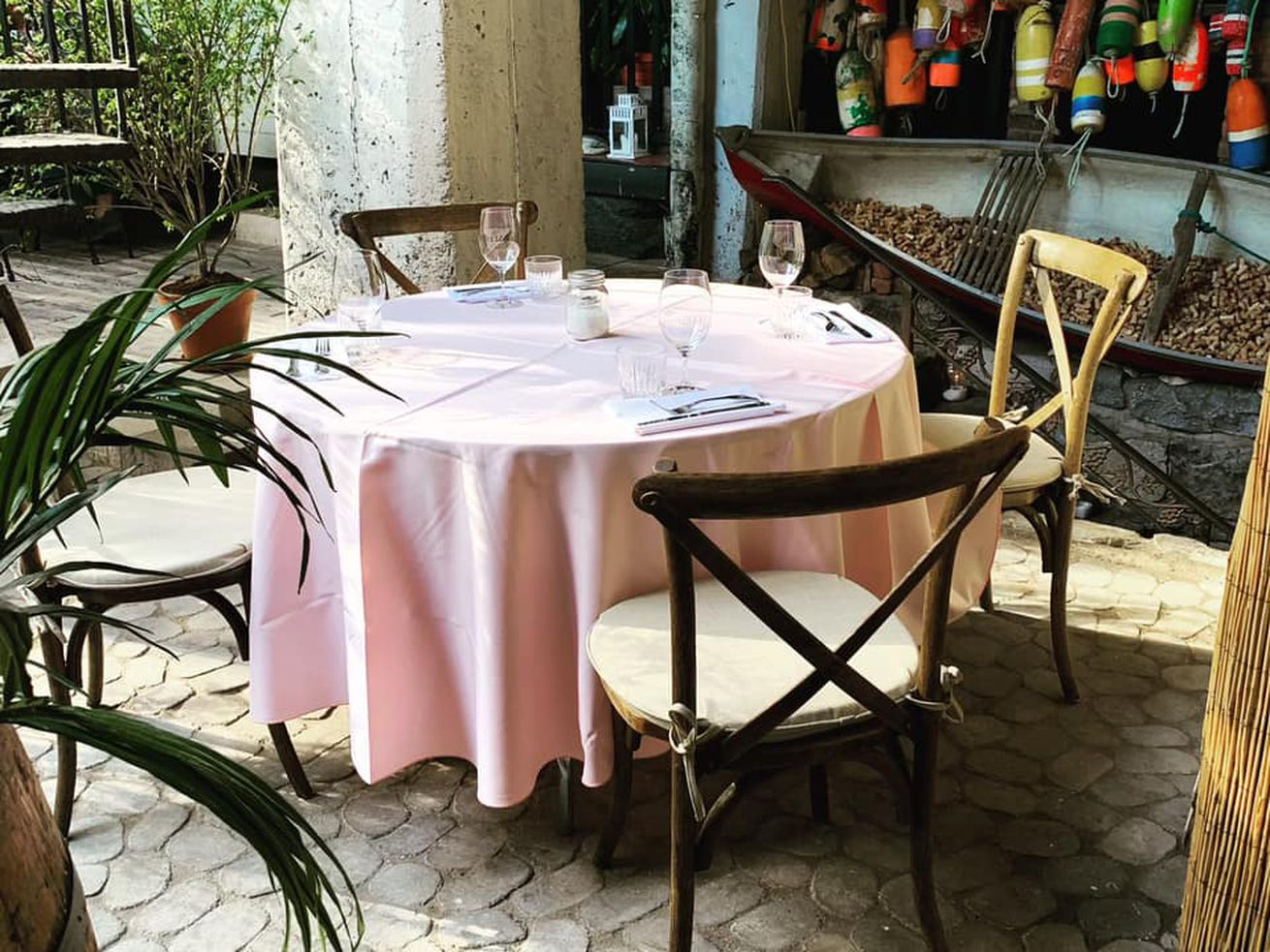 inside of restaurant with pink table cloth