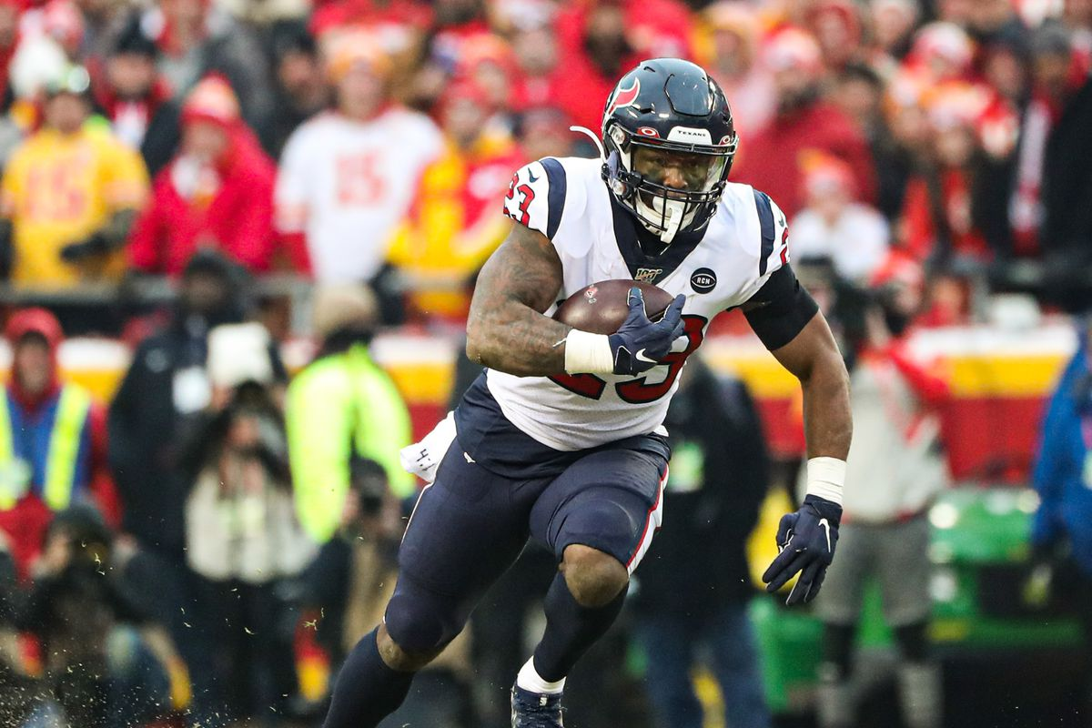 Houston Texans running back Carlos Hyde runs against the Kansas City Chiefs during the first half in a AFC Divisional Round playoff football game at Arrowhead Stadium.