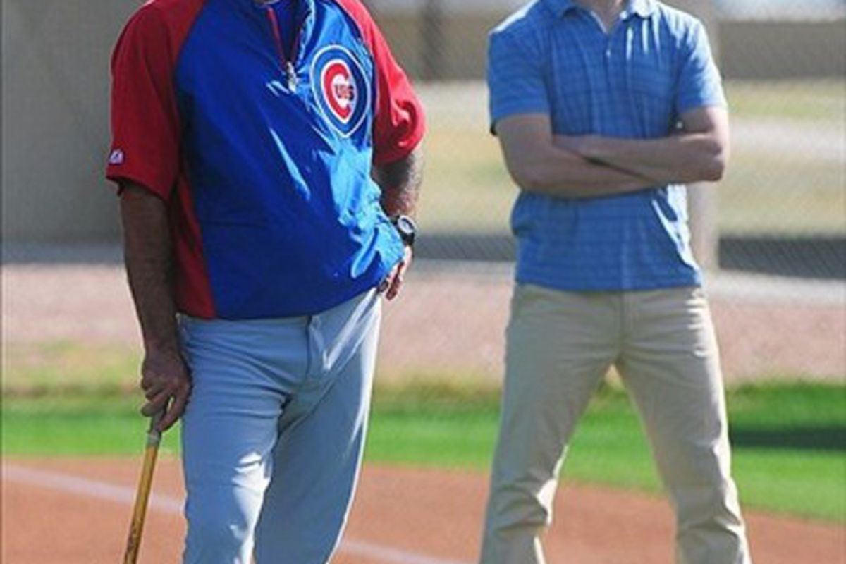 February 23, 2012; Mesa, AZ, USA; Chicago Cubs manager Dale Sveum (left) and president Theo Epstein (right) watch the inaugural match play bunting tournament during spring training at Fitch Park. Mandatory Credit: Kyle Terada-US PRESSWIRE