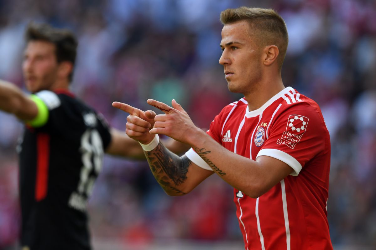 MUNICH, GERMANY - APRIL 28: Niklas Dorsch of Bayern Muenchen celebrates scoring the opening goal during the Bundesliga match between FC Bayern Muenchen and Eintracht Frankfurt at Allianz Arena on April 28, 2018 in Munich, Germany.