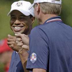 USA's Tiger Woods and Steve Stricker have some fun during a practice round at the Ryder Cup PGA golf tournament Wednesday, Sept. 26, 2012, at the Medinah Country Club in Medinah, Ill.