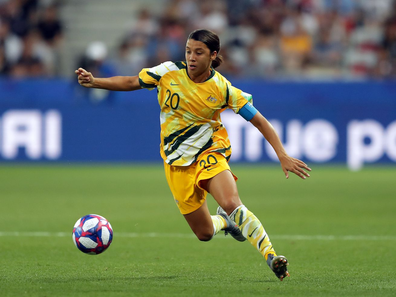 Sam Kerr of Australia runs with the ball during the 2019 FIFA Women's World Cup France Round Of 16 match between Norway and Australia at Stade de Nice on June 22, 2019 in Nice, France.