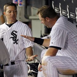 Chicago White Sox starting pitcher Jake Peavy, left, and designated hitter Adam Dunn celebrate in the dugout after Dunn's three-run double off Baltimore Orioles starting pitcher Tommy Hunter in the seventh inning of a baseball game Wednesday, April 18, 2012, in Chicago.