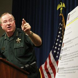 Polk County Sheriff Grady Judd talks about the events leading up to the arrest over the weekend of two juvenile girls in a Florida bullying case at a press conference in Winter Haven, Fla., Monday, Oct. 15, 2013.