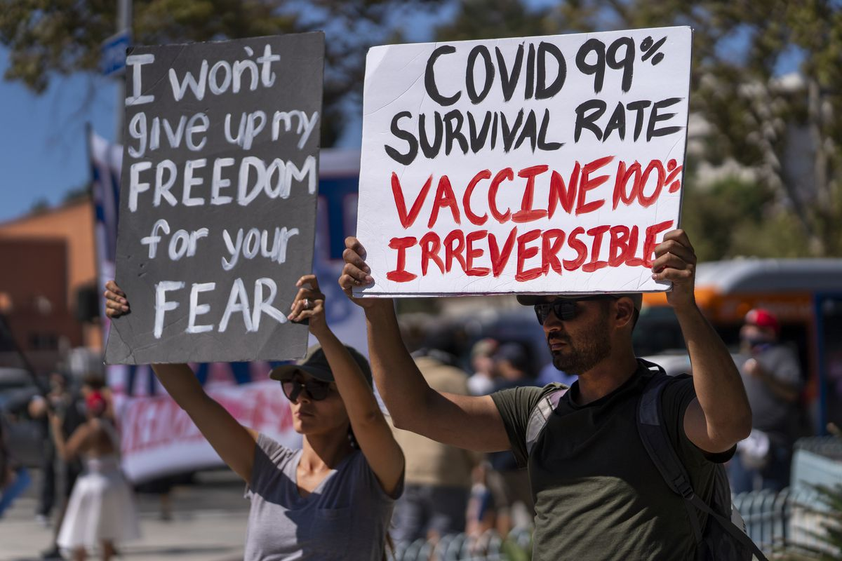 Protesters opposing COVID-19 vaccine mandates hold a rally on Sept. 18 n front of City Hall in downtown Los Angeles.