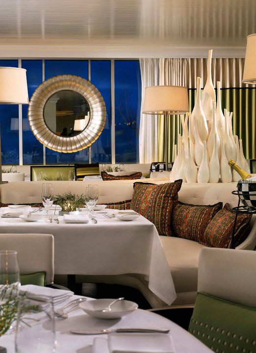 Upscale restaurant interior with white tablecloths