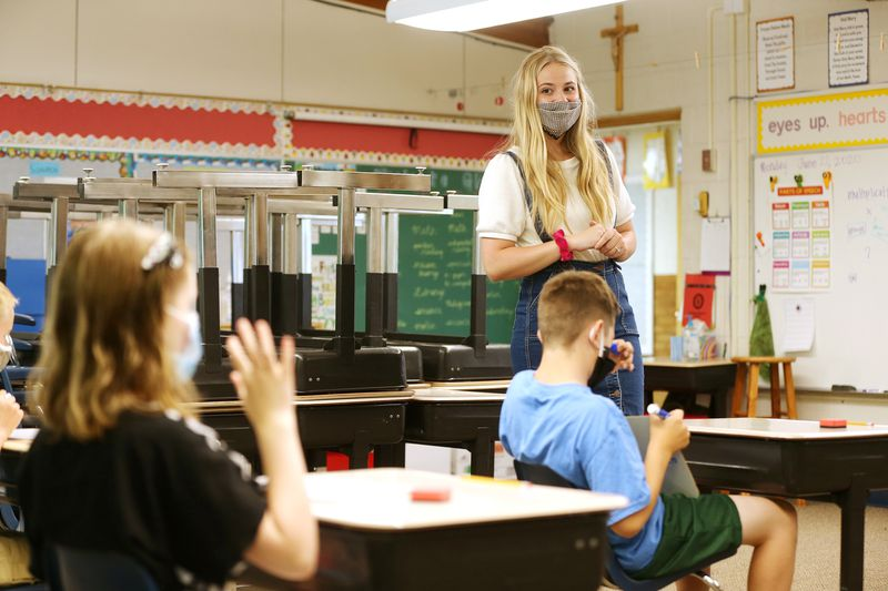 Hailey Liljenquist works with her math students at J.E. Cosgriff Memorial Catholic School in Salt Lake City on Monday, June 22, 2020. The school is offering a modest summer program for students.