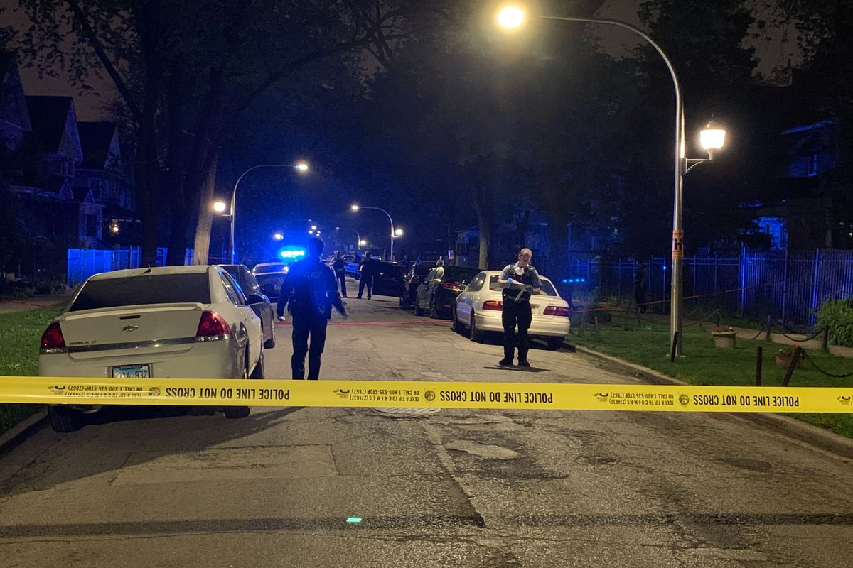 Police investigate after two men were shot, one of them fatally, the 100 block of North Lorel Avenue May 22, 2020.
