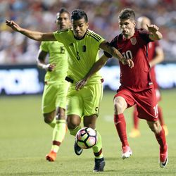 Venezuela's Francisco Flores (5) and United States midfielder Christian Pulisic (10) fight for the ball during a soccer game at Rio Tinto Stadium in Sandy on Saturday, June 3, 2017. They tied 1-1.