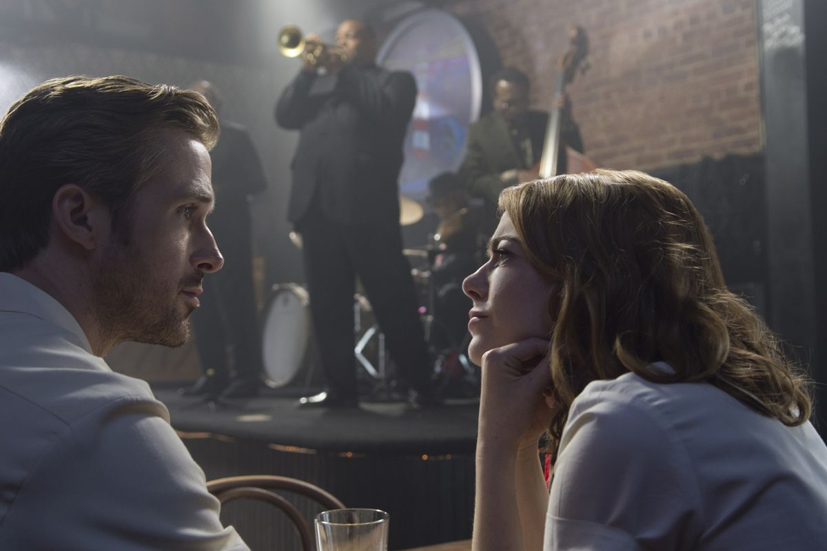 Emma Stone ponders the face of Ryan Gosling while a jazz band plays