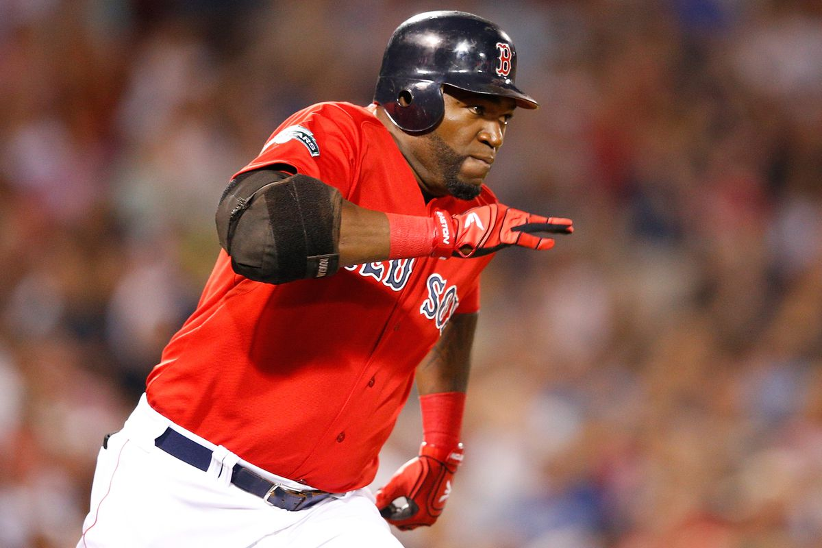 BOSTON, MA - AUGUST 24:  David Ortiz #34 of the Boston Red Sox legs out a double against the Kansas City Royals at Fenway Park on August 24, 2012 in Boston, Massachusetts.  (Photo by Jim Rogash/Getty Images)