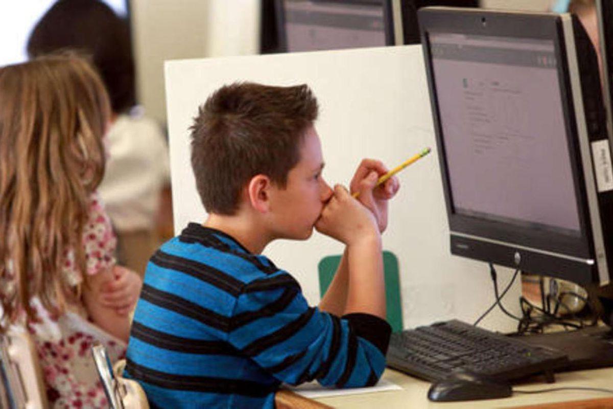 FILE: Students take a practice SAGE test at Polk Elementary School in Ogden on Thursday, April 17, 2014.