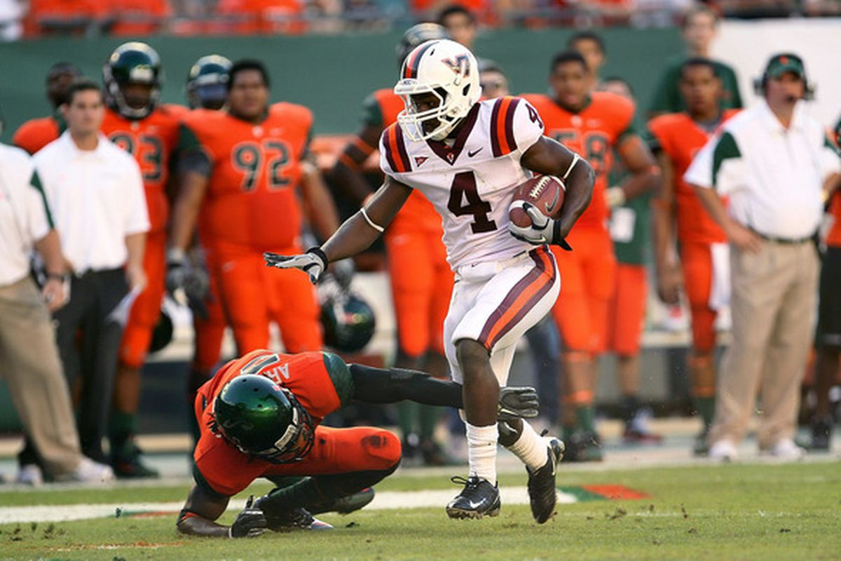 MIAMI - NOVEMBER 20:  David Wilson #4 of the Virginia Tech Hokies runs for a first down during a game against the Miami Hurricanes at Sun Life Stadium on November 20 2010 in Miami Florida.  (Photo by Mike Ehrmann/Getty Images)