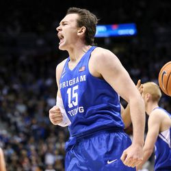 FILE: Brigham Young Cougars forward Payton Dastrup (15) yells after being fouled by Utah Utes forward Tyler Rawson (21) at the Marriott Center in Provo on Saturday, Dec. 16, 2017.