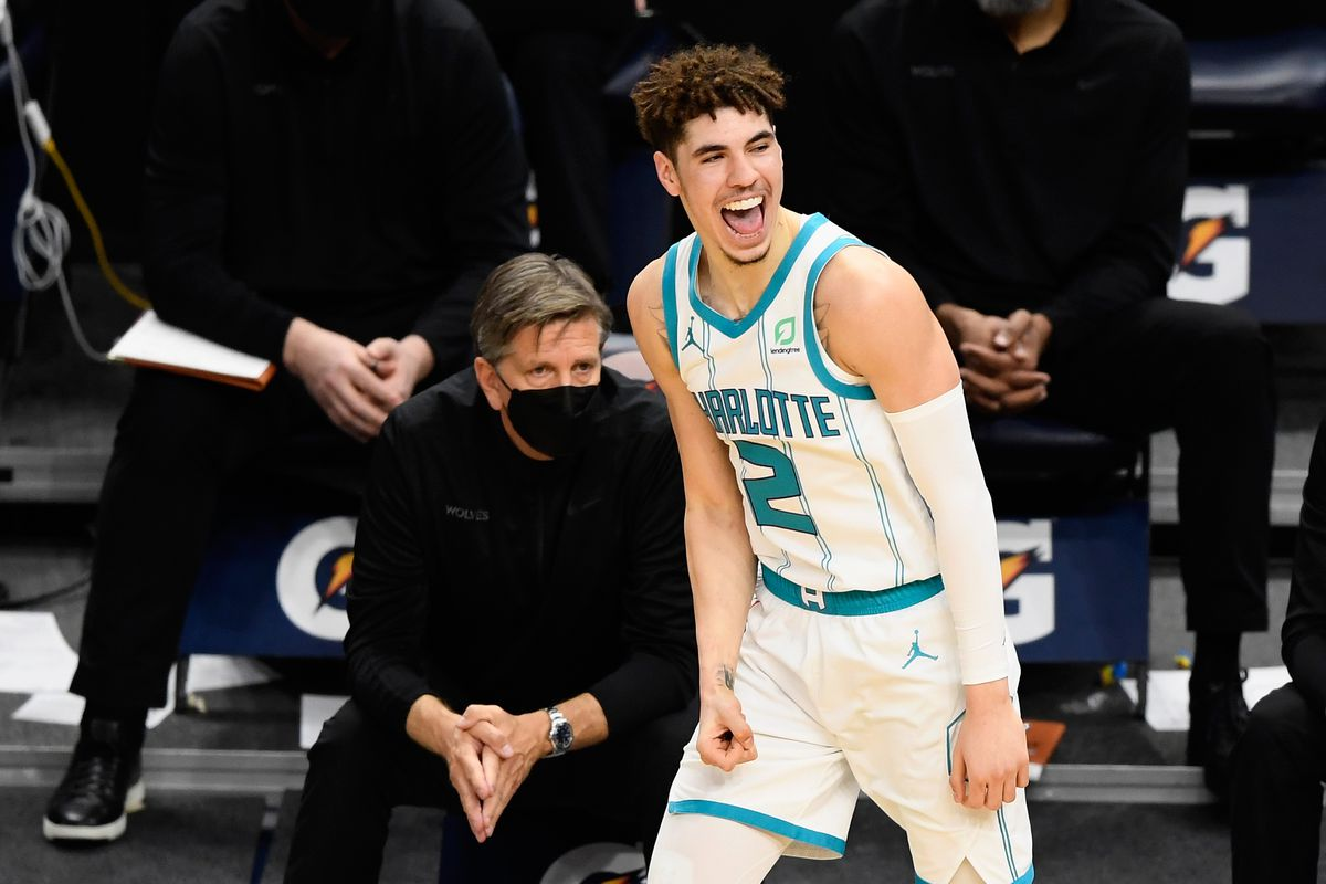 Head coach Chris Finch of the Minnesota Timberwolves looks on as LaMelo Ball of the Charlotte Hornets celebrates a three-point basket during the fourth quarter of the game at Target Center on March 3, 2021 in Minneapolis, Minnesota.