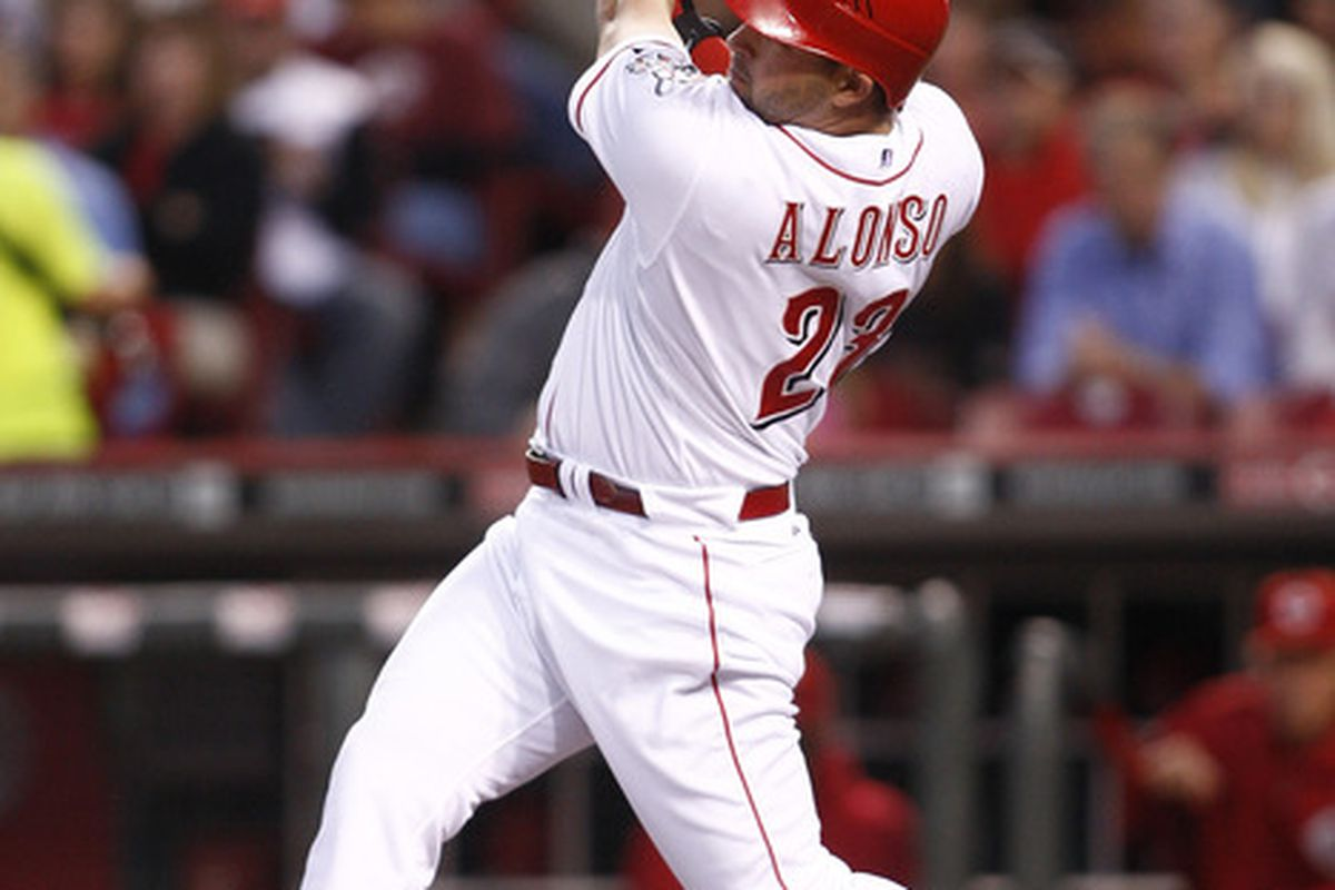 Yonder Alonso connects for a solo home run during the game against the Milwaukee Brewers on September 17, 2011 at Great American Ball Park in Cincinnati, Ohio.  The Brewers defeated the Reds 10-1.   (Photo by John Grieshop/Getty Images)