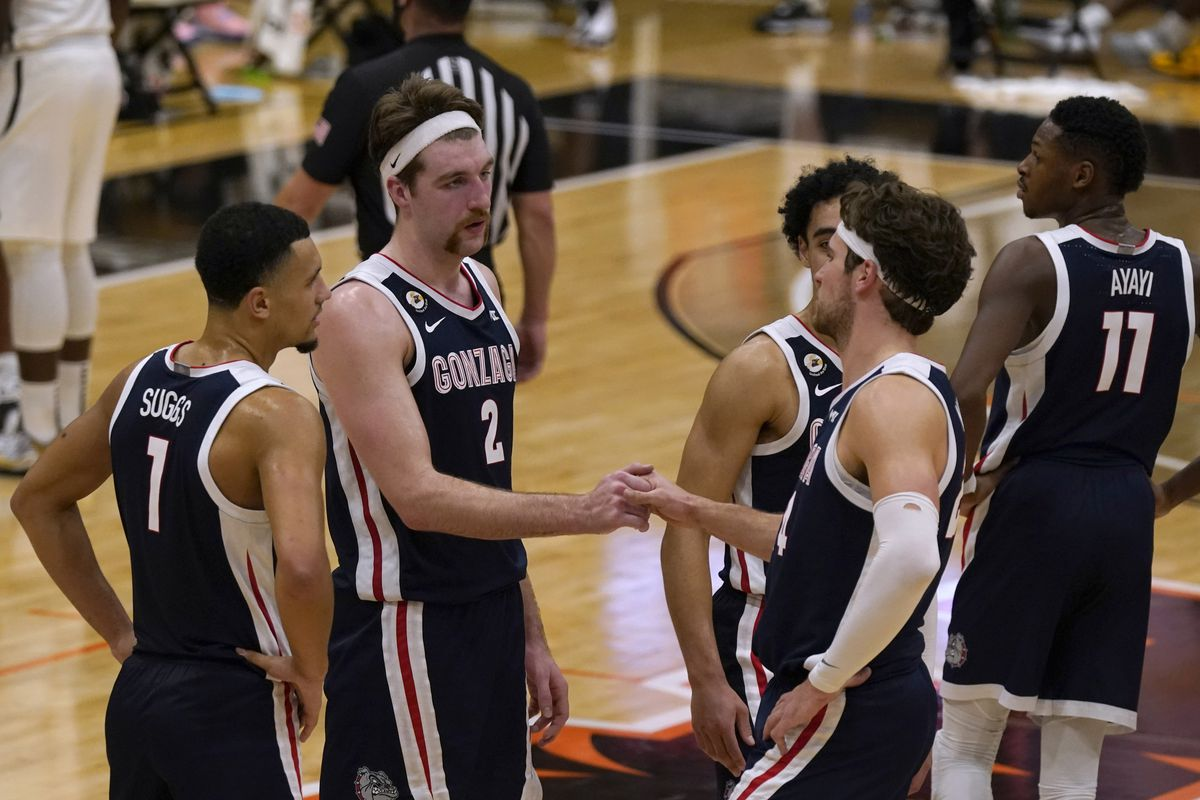 Gonzaga Bulldogs forward Drew Timme and forward Corey Kispert shake hands in the closing moments of a 76-58 victory over the Pacific Tigers at Alex G. Spanos Center.