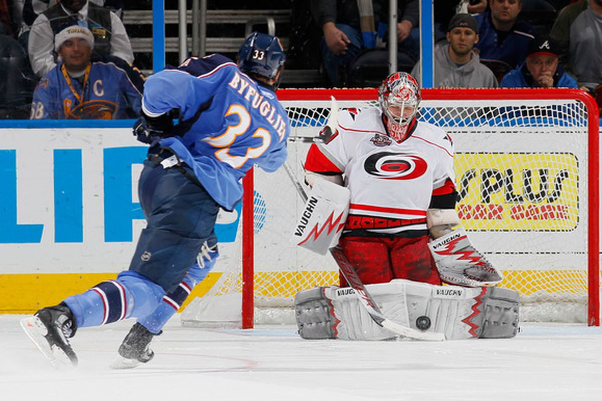 Cam Ward stops Dustin Byfuglien's shootout slapshot, setting up Sergei Samsonov's game-winning attempt. Ward made a season-high 45 saves to earn his 13th win of the season.  (Photo by Kevin C. Cox/Getty Images)