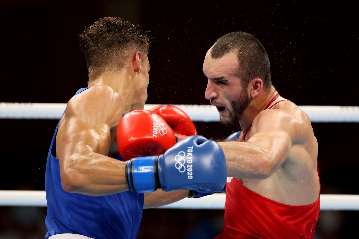Muslim Gadzhimagomedov (red) of Team Russian Olympic Committee exchanges punches with David Nyika of Team New Zealand during the Men's Heavy (81-91kg) semi final on day eleven of the Tokyo 2020 Olympic Games at Kokugikan Arena on August 03, 2021 in Tokyo, Japan.