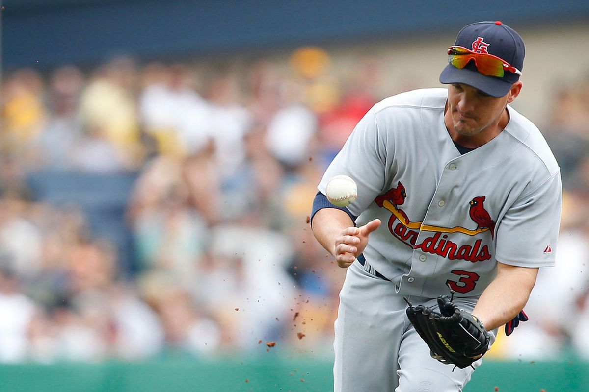 PITTSBURGH - JULY 24:  Ryan Theriot #3 of the St Louis Cardinals misplays a ground ball in the infield against the Pittsburgh Pirates during the game on July 24, 2011 at PNC Park in Pittsburgh, Pennsylvania.  (Photo by Jared Wickerham/Getty Images)