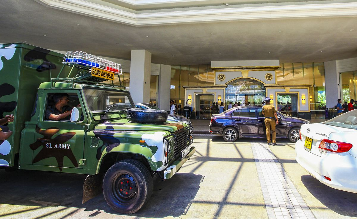 Security forces inspect the scene after a blast targeting Cinnamon Grand hotel in Colombo. Officials believe the attacks were conducted by people wearing suicide bombs.