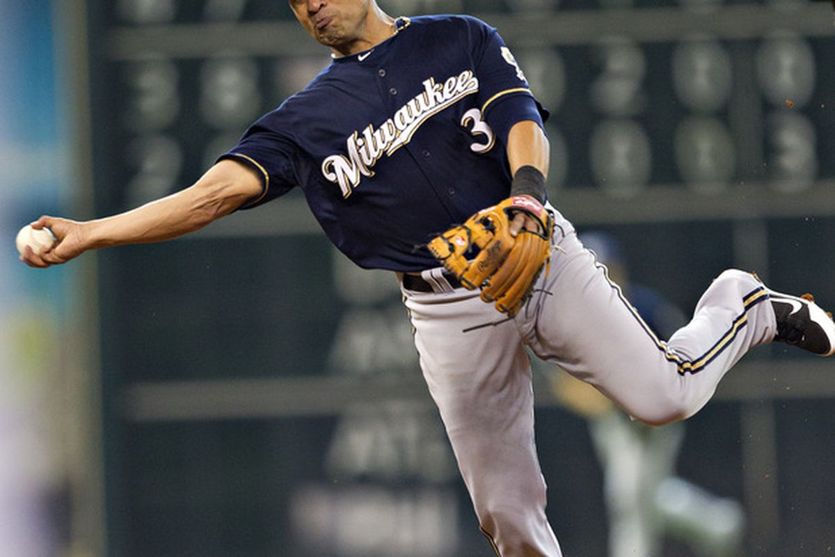 HOUSTON,TX- JULY 07:  Cesar Izturis #3 of the Milwaukee Brewers throws off balance to first base against the Houston Astros on July 7, 2012 at Minute Maid Park in Houston, Texas.(Photo by Bob Levey/Getty Images)