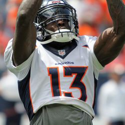 Broncos WR Steven Dunbar looks up and reaches for a pass.