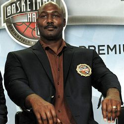 Basketball Hall of Fame inductee Karl Malone shows his new jacket with sleeves much too short during the enshrinement news conference at the Hall of Fame in Springfield, Mass., Friday.