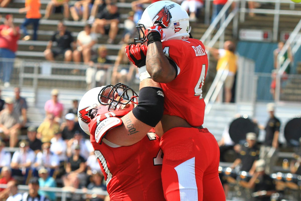 Ball State OL Jordan Hansel was one of the MAC's better individual performers in 2013. Seen here hoisting Horactio Banks after he helped plow the way for the running back's score.